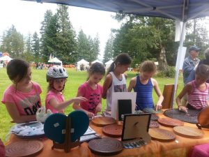 Lisa's booth at the Fair. Children are captivated by the Cedar Labyrinths