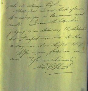 Sepia photo of a page with cursive writing