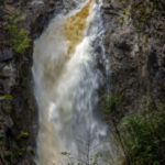 Colour photo of waterfall over a narrow cliff